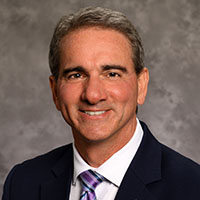 Photo of                                   John M. DelGaudio MD