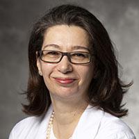 Photo of                                   Nicki Panoskaltsis MD, PhD, FRCP